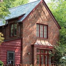 Traditional Exterior by Innovative Construction & Roofing