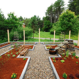 Photo of a large traditional full sun backyard mulch landscaping in Portland Maine for summer.