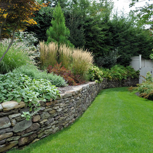 Inspiration for a traditional retaining wall landscape in New York.