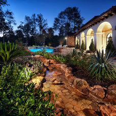 Mediterranean Landscape by JAUREGUI Architecture Interiors Construction