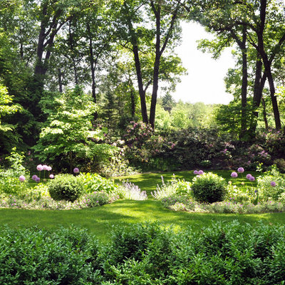 Photo of a large traditional shade backyard stone landscaping in Boston for summer.