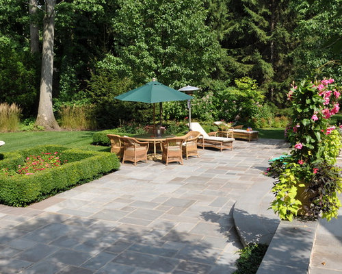 Inspiration For A Traditional Backyard Stone Landscaping In Chicago.
