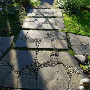 This is an example of an eclectic shade stone landscaping in Portland.