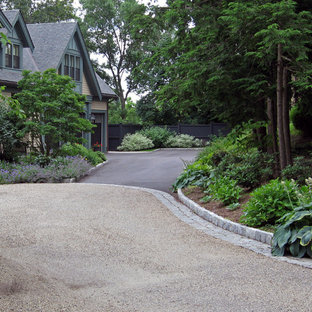 Inspiration for a large traditional partial sun front yard gravel driveway in Boston.