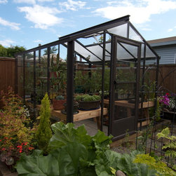 The Legacy 8x8 Greenhouse - The Legacy hobby greenhouse provides the best of both worlds for those gardeners with big dreams and small greenhouse plans! A sturdy 8x8 hobby greenhouse, The Legacy is built with insulating twinwall polycarbonate in the roof and beautiful single glass sidewalls to peek into your garden. The heavy duty aluminum frame is Rideau brown, a contemporary and upscale color for today's homeowner. Designed to withstand 30 pounds per square foot of snow 80 mph high winds, this draft free and air tight structure is a great value hobby greenhouse!