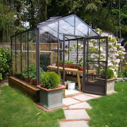 "The Legacy 8x8 Greenhouse - The Legacy is one of our most popular starting greenhouses.  At 8x8 with 5'6"" sidewalls, it leaves a great deal of space for the new greenhouse gardener.  The clear, single tempered glass sidewalls allow a beautiful view into the garden and the polycarbonate roof panels help retain heat in cooler climates."