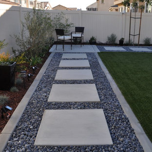 Inspiration for a small modern drought-tolerant and partial sun backyard concrete paver landscaping in San Diego.