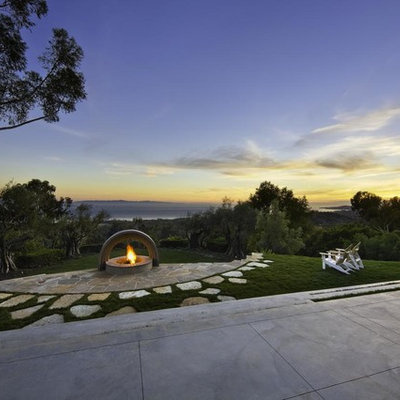 This is an example of a contemporary backyard landscaping in Santa Barbara with a fire pit.