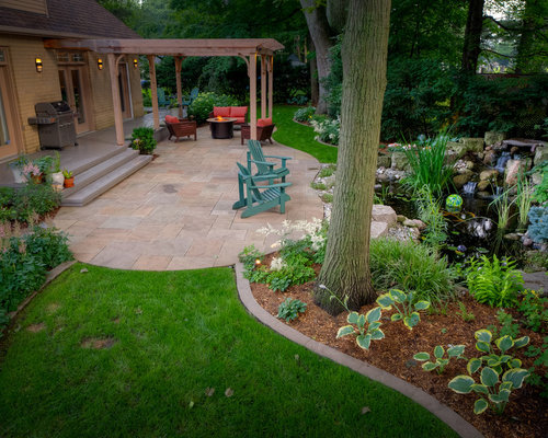 Inspiration For A Timeless Patio Remodel In Toronto With A Fire Pit And A  Pergola