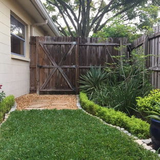 This is an example of a mid-sized traditional full sun backyard concrete paver landscaping in Tampa for summer.
