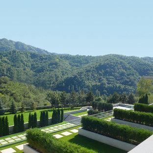 Design ideas for a huge full sun hillside concrete paver formal garden in New York.