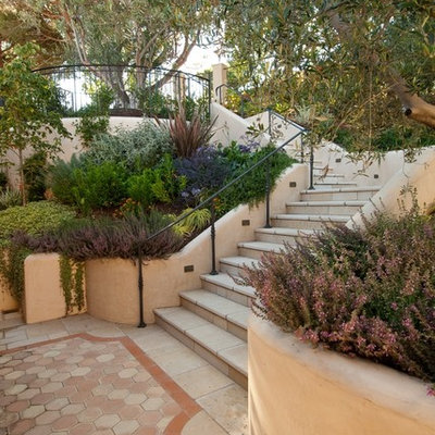 This is an example of a mediterranean hillside stone landscaping in San Francisco.
