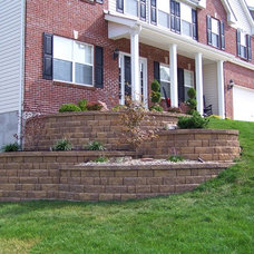 Traditional Landscape by Action Landscaping Inc