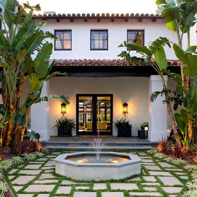 This is an example of a mediterranean front yard water fountain landscape in Los Angeles.