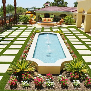 Inspiration for a huge mediterranean partial sun backyard stone water fountain landscape in Phoenix for fall.