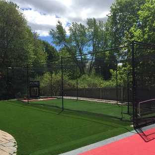 Photo of a large traditional backyard outdoor sport court in Boston.
