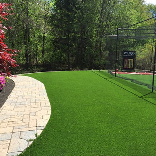 Inspiration for a large traditional backyard outdoor sport court in Boston.