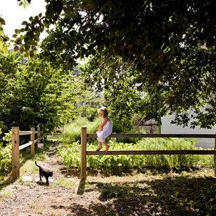 Inspiration for a farmhouse backyard vegetable garden landscape in Portland.
