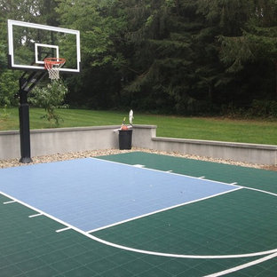 Photo of a large traditional partial sun backyard outdoor sport court in Boston.