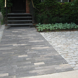 This is an example of a small transitional partial sun front yard stone landscaping in Toronto for summer.