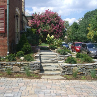 Design ideas for a mid-sized transitional full sun front yard concrete paver landscaping in DC Metro for spring.