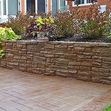 Traditional Landscape by Foundation Builders LLC
