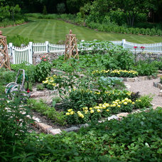 Traditional Landscape by GreenCraft Associates