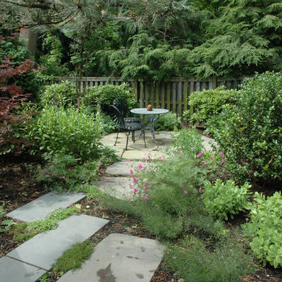 Design ideas for a traditional backyard stone landscaping in Boston.