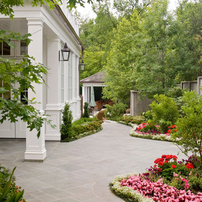 Design ideas for a mid-sized traditional full sun side yard stone formal garden in Dallas for summer.