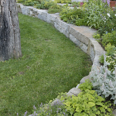This is an example of a traditional backyard landscaping in Manchester.