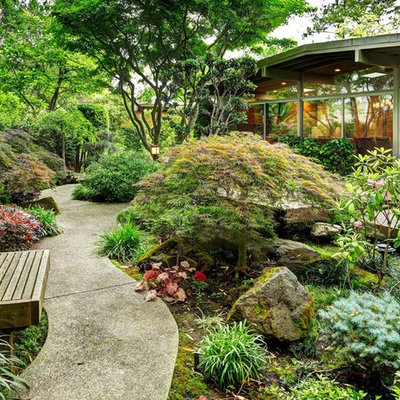 Inspiration for a traditional backyard concrete paver landscaping in Other.