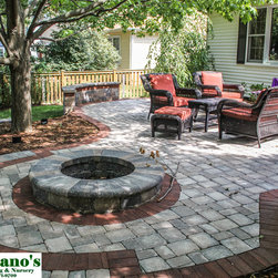 Hardscape - Bordered brick patio with firepit and seating wall.