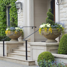 Traditional Landscape by Outdoor Elements Group Inc.