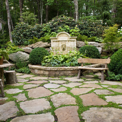 This is an example of a traditional shade backyard stone landscaping in Atlanta.