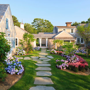 Traditional backyard shaded garden in Boston with natural stone pavers.