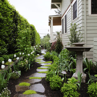 Inspiration for a traditional partial sun side yard stone garden path in Portland for spring.