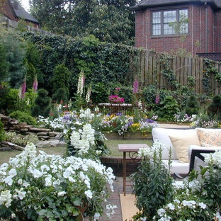 Inspiration for a large traditional backyard landscaping in Birmingham for summer.