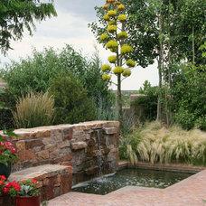 Mediterranean Landscape by Clemens & Associates Inc.