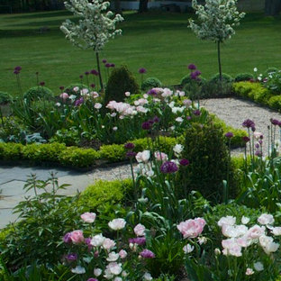Inspiration for a small traditional backyard gravel formal garden in Charlotte for spring.
