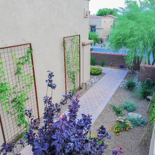 Inspiration for a mid-sized southwestern drought-tolerant and partial sun side yard brick garden path in Phoenix.