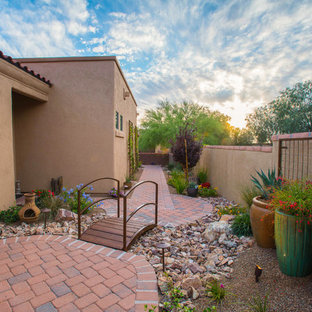 Design ideas for a mid-sized southwestern drought-tolerant and partial sun side yard brick garden path in Phoenix.