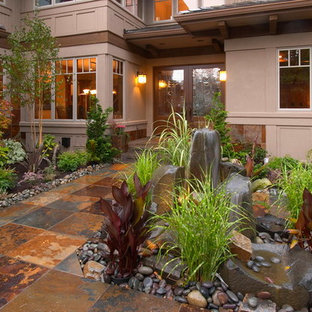 Design ideas for a mid-sized rustic front yard stone garden path in Seattle.