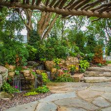 Traditional Landscape by Aquascape Inc.