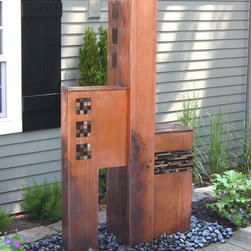 Tricubic - Water feature made from Copper with applied patina incorporating stone and glass tiles.