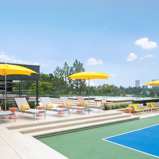 This is an example of a large contemporary full sun backyard outdoor sport court in Orange County.