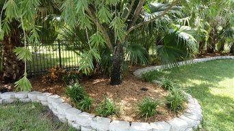 Tropical Backyard with Retaining Wall