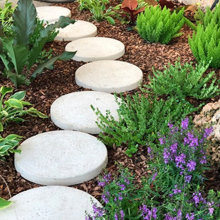 Inspiration for a small tropical full sun front yard concrete paver garden path in Miami for winter.