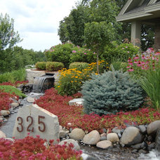 Traditional Landscape by MH3 Design Group