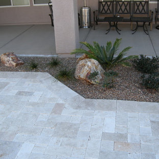 This is an example of a mid-sized contemporary drought-tolerant and partial sun backyard gravel landscaping in Phoenix with a fire pit for summer.