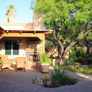 Photo of a mid-sized mediterranean drought-tolerant and partial sun backyard brick landscaping in Phoenix with a fire pit for summer.
